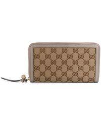 fd243564e349 Gucci - GG Supreme Zip Around Wallet - Lyst