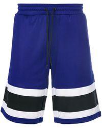 AMI Pantaloni corti con banda bicolore