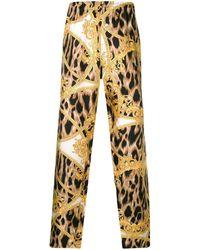 Versace - Leopard Baroque Print Pants - Lyst