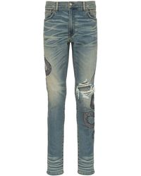 Amiri - Snake Embroidered Distressed Jeans - Lyst