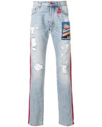 Gcds - Contrast Side Panel Distressed Jeans With A Patch Detail - Lyst