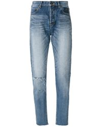 Saint Laurent - Distressed Tapered Fit Jeans - Lyst