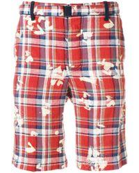 Sacai - Shorts a cuadros con manchas - Lyst