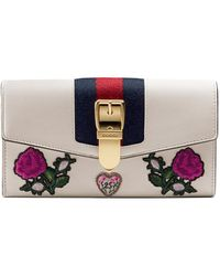 f20e1ee18d82 Gucci Women's Sylvie Leather Flap Wallet - Hibiscus Red in Red - Lyst