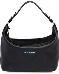 879299ba6fd8 Studded Nylon Shopper. £1,170. Farfetch · Prada - Concept Bag - Lyst