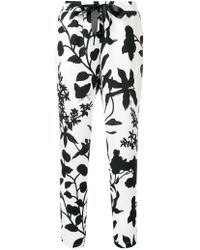 Liu Jo - 'leaves Silhouettes' Print Trousers - Lyst