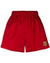 Prada - Logo Patch Shorts - Lyst