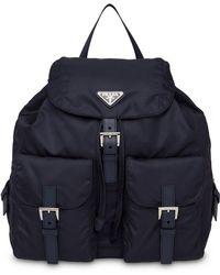 cb4b313db796 Black Nylon Bucket Pouch. £210. SSENSE · Prada - Vela Backpack - Lyst