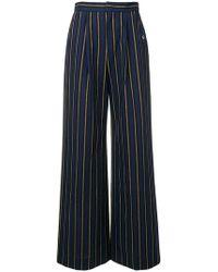 Etudes Studio - Transition Flare Trousers - Lyst