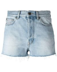 Saint Laurent - Shorts denim con apliques - Lyst