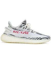 e8d01a167943 Lyst - Jeremy Scott for adidas Fake Fur Zebra Print High Top Sneakers