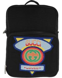 7edd24c62848 Gucci Patch Embellished Leather Trimmed Canvas Backpack in Yellow ...