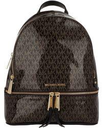 d35cdef441d5 Michael Kors Rhea Zip Xs Messenger Backpack Gold Black in Metallic ...
