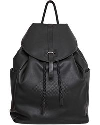 Alexander McQueen Perforated Skull Soft Leather Backpack - Lyst