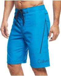 Calvin Klein Solid Swim Shorts blue - Lyst