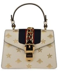 bc0ebd76675f Gucci Bee Clasp Striped Leather Shoulder Bag in Red - Lyst