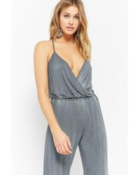 9f0012930ae Forever 21 - Women s Surplice Mineral Wash Jumpsuit - Lyst