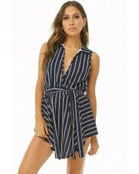 8571e1abdc7 Lyst - Forever 21 Floral Cutout Playsuit in Black