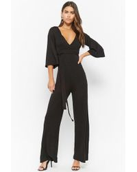 851434cf0ea Lyst - Forever 21 Surplice Woven Jumpsuit in Black