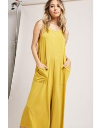bf96875dde6 Lyst - Forever 21 Contemporary Pleated Wide-leg Overalls in Green