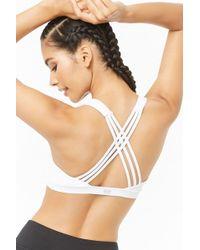 f862ed485c Charlotte Russe · Forever 21 - Medium Impact - Caged Sports Bra - Lyst
