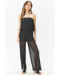 39ebc6a2c9a Lyst - Forever 21 Oh My Love Star Print Flounce Jumpsuit in Black