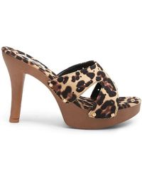 9085984f8d9 Lyst - Forever 21 Leopard Print Flat Mules in Brown