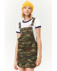 bfd642cf73 Forever 21 - Camo Denim Overall Mini Dress - Lyst