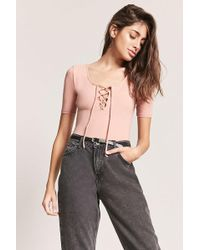 6a23014dd2 Lyst - Forever 21 Lace-up Bodysuit in White