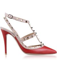 aa9540832f29 Valentino  rockstud  Caged Patent Leather Pumps in Yellow - Lyst