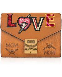131aa5a3a MCM Love Patch Visetos Passport Holder - Lyst
