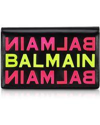 Balmain - Black Smooth Leather Clutch W/neon Metallic Logo - Lyst