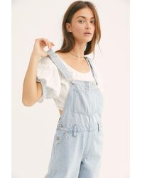 e799057134 Lyst - Free People Levi s Baggy Denim Overalls in Blue