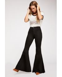 b292e286bfd965 Free People Crvy Robin High-rise Flare Jeans By We The Free in Blue - Lyst