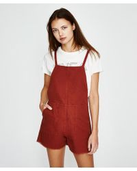 RVCA - Crush Shorty Overall Rust - Lyst
