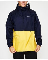 Patagonia - Torrentshell Pullover Navy Blue W Rugby Yellow Navy Yellow - Lyst