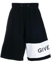 Givenchy - Oversized Asymmetric Logo Track Shorts - Lyst