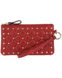 cdfaa6ad915 Valentino Rockstud Spike Leather Saddle Bag in Red - Lyst