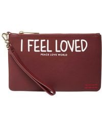 Peace Love World - Imprinted Wristlet Clutch - Lyst