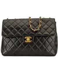 30de705b6e4570 Chanel - Black Quilted Lambskin Leather Classic Jumbo Single Flap Bag - Lyst
