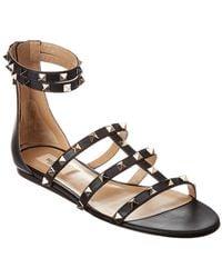 63d4bbf5132 Lyst - Valentino Rockstud T-strap Flat Sandal in Black