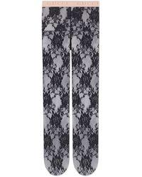 Gucci Collants en dentelle à imprimé Flora - Noir