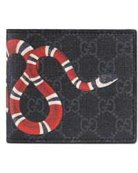 edbc7dab0a4 Gucci - Portefeuille avec porte-monnaie Suprême GG à imprimé Kingsnake -  Lyst