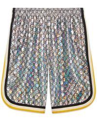 Gucci - Shorts in jersey laminato GG brillante - Lyst