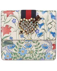 Gucci - Totem New Flora Print Leather Clutch - Lyst