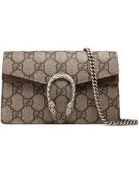 45ec4d950794f4 ... 32494fe3c8c Gucci Multicolor Medium Gg Supreme Broche Bag in Natural -  Lyst ...
