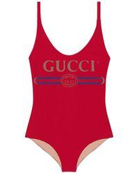 9bd3159425a7c6 Gucci - Maillot de bain brillant avec logo - Lyst