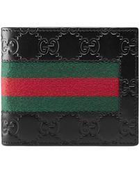 Gucci - Portamonete in pelle Signature con dettaglio Web - Lyst