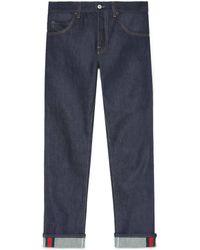 8d1d9e5019c Gucci - Jean fuselé bleu foncé avec détail ruban Web - Lyst