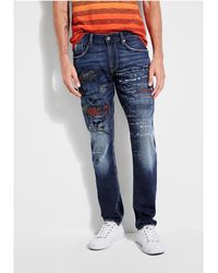 Guess - Embroidered Slim Tapered Jeans - Lyst